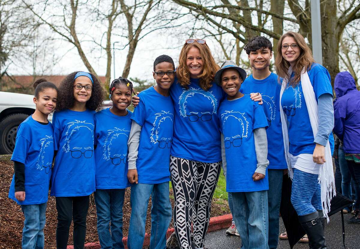 FILE - This March 20, 2016, file photo shows Hart family of Woodland, Wash., at a Bernie Sanders rally in Vancouver, Wash. A body was recovered Saturday, April 7, 2018, in the vicinity where an SUV plunged off a Northern California cliff last month, killing the family of eight in what authorities suspect may have been an intentional crash. Jennifer Hart, who was driving the vehicle, had a blood alcohol content above the legal limit at the time of the crash, according to California Highway Patrol.