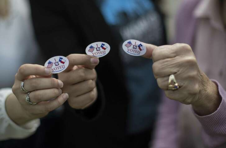 "Hispanic voters show their ""I Voted"" stickers after casting their vote early, Friday, March 2, 2018, in Houston during the Harris County Primaries."