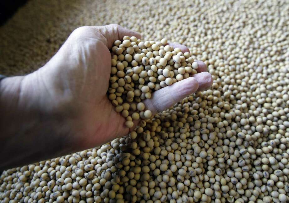 Sorted soybeans are ready for shipment and planting at Taylor Seed Farm near White Cloud, Kan., Thursday, April 5, 2018. China is the largest buyer of American soybeans in the world, accounting for almost 60 percent of U.S. soy exports worth $12.4 billion in revenue for the year that ended on Aug. 31. Photo: Orlin Wagner /Associated Press / Copyright 2018 The Associated Press. All rights reserved.