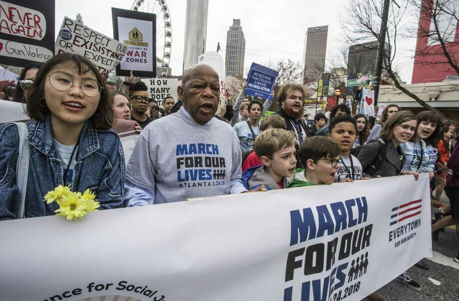 U.S. Rep. John Lewis leads a march of thousands through the streets of Atlanta, Ga., on March 24. On Friday, there will be a national high school walkout, guns again the cause. Photo: Ron Harris /Associated Press / Copyright 2018 The Associated Press. All rights reserved.