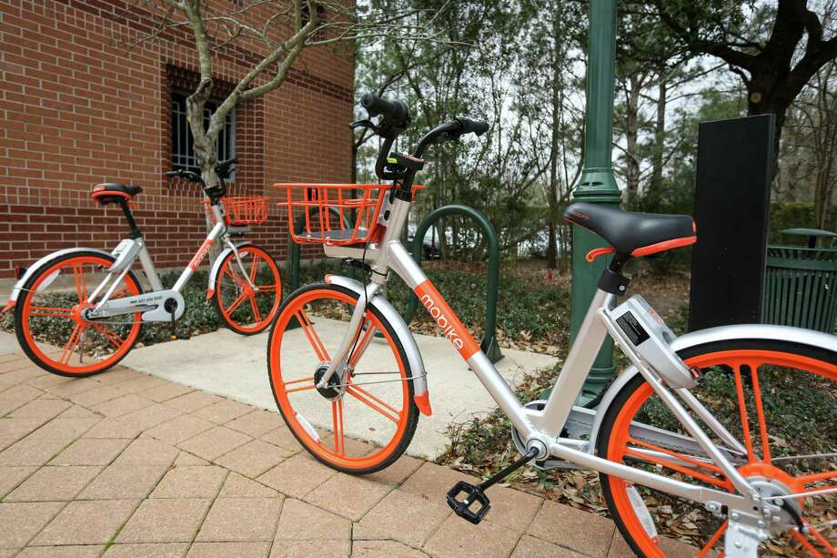 Bicycles from Mobike, a bike sharing company, are pictured on Tuesday, Feb. 20, 2018, at Town Green Park in The Woodlands. Residents and visitors have downloaded the Mobike app more than 7,000 times since the service debuted in early January. Photo: Michael Minasi, Staff Photographer / Houston Chronicle / © 2017 Houston Chronicle