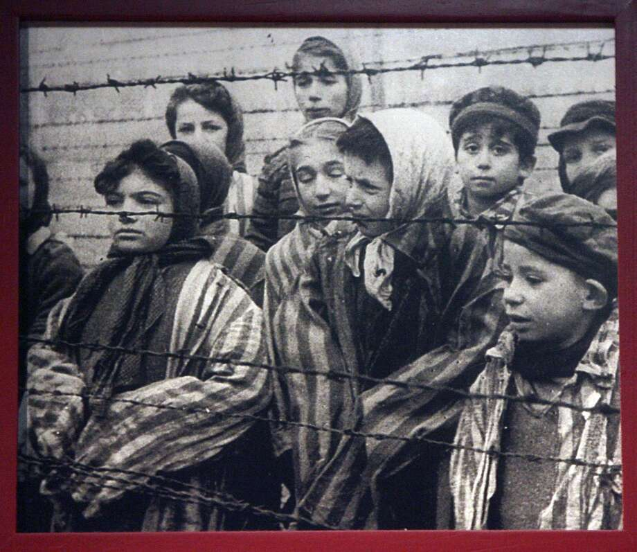 A photograph on the wall at the Holocaust Memorial Museum of San Antonio shows children at Auschwitz. Stop comparing today's political squabbles to what Hitler inflicted on the world. Photo: JOHN DAVENPORT /SAN ANTONIO EXPRESS-NEWS / jdavenport@express-news.net