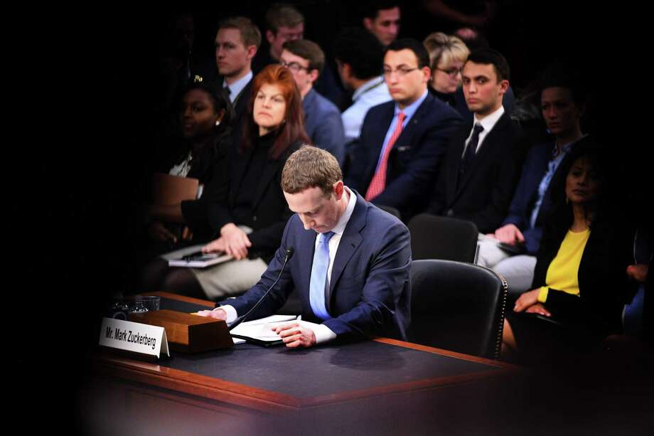 Facebook founder and CEO Mark Zuckerberg testifies during a Senate Commerce, Science and Transportation Committee and Senate Judiciary Committee joint hearing about Facebook on Capitol Hill Tuesday. Zuckerberg apologized to lawmakers for the leak of personal data on tens of millions of users as he faced a day of reckoning before a Congress mulling regulation of the global social media giant. Photo: JIM WATSON /AFP /Getty Images / AFP or licensors