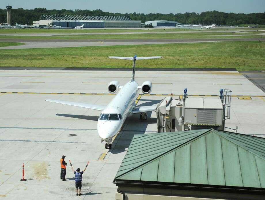 A plane returns to the terminal at Westchester County Airport in White Plains, N.Y. Tuesday, Aug. 1, 2017. Photo: Tyler Sizemore / Hearst Connecticut Media / Greenwich Time