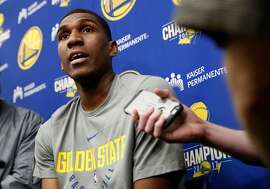 Warriors' Kevon Looney talks with the media as the Golden State Warriors prepare for game one of the NBA playoffs against the San Antonio Spurs in Oakland, Ca., on Fri. April 13, 2018.