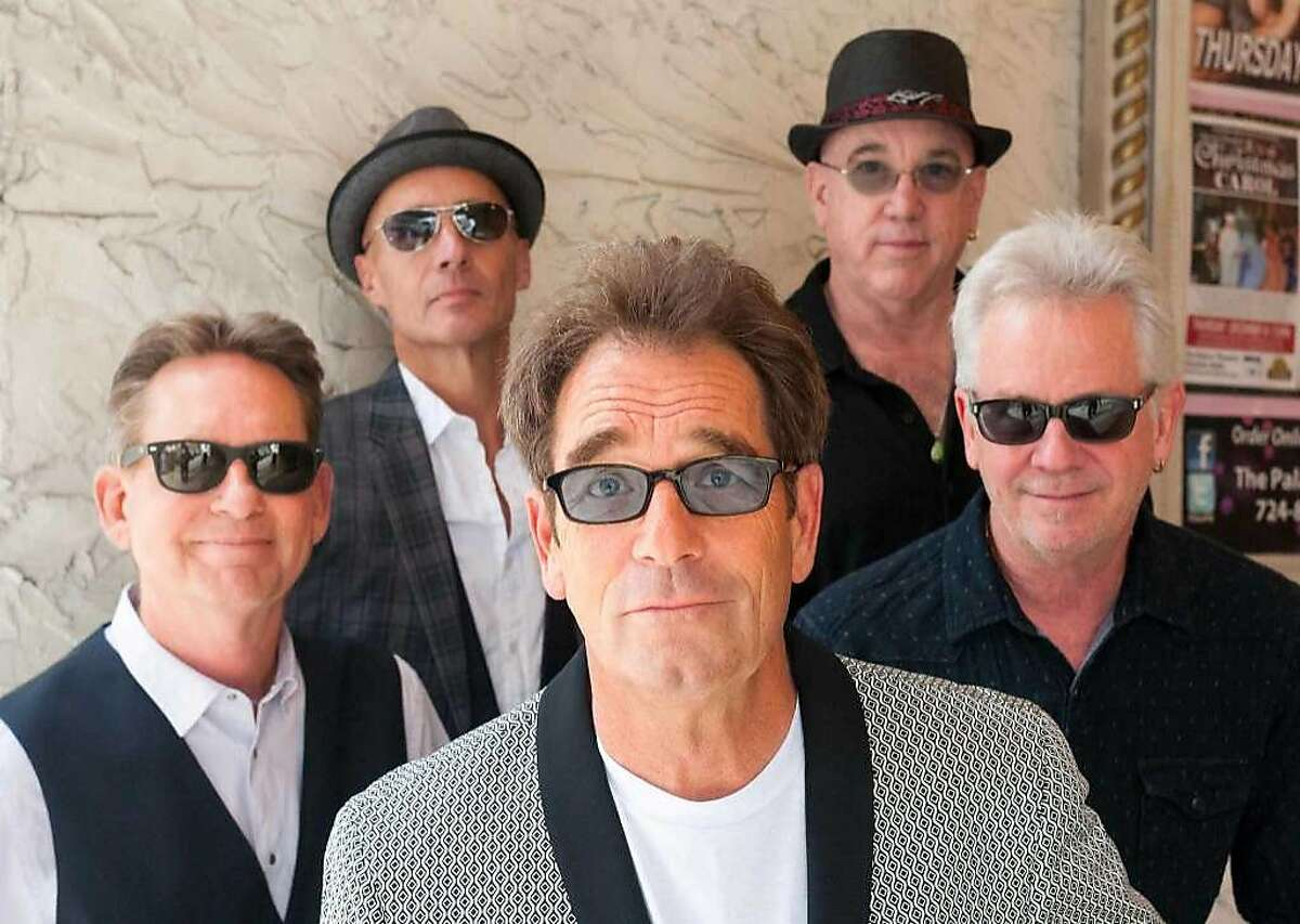 Huey Lewis, center, and The News