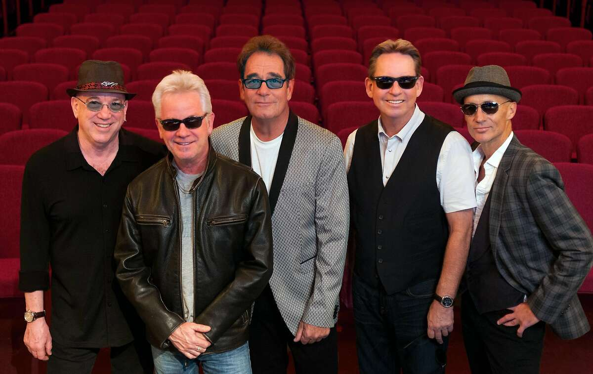 Huey Lewis, center, and The News.