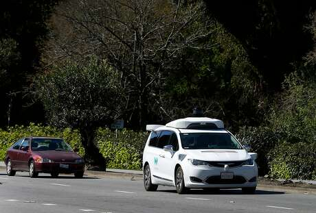A Waymo self-driving car is test driven on San Antonio Road in Mountain View, Calif. on Wednesday, March 28, 2018.