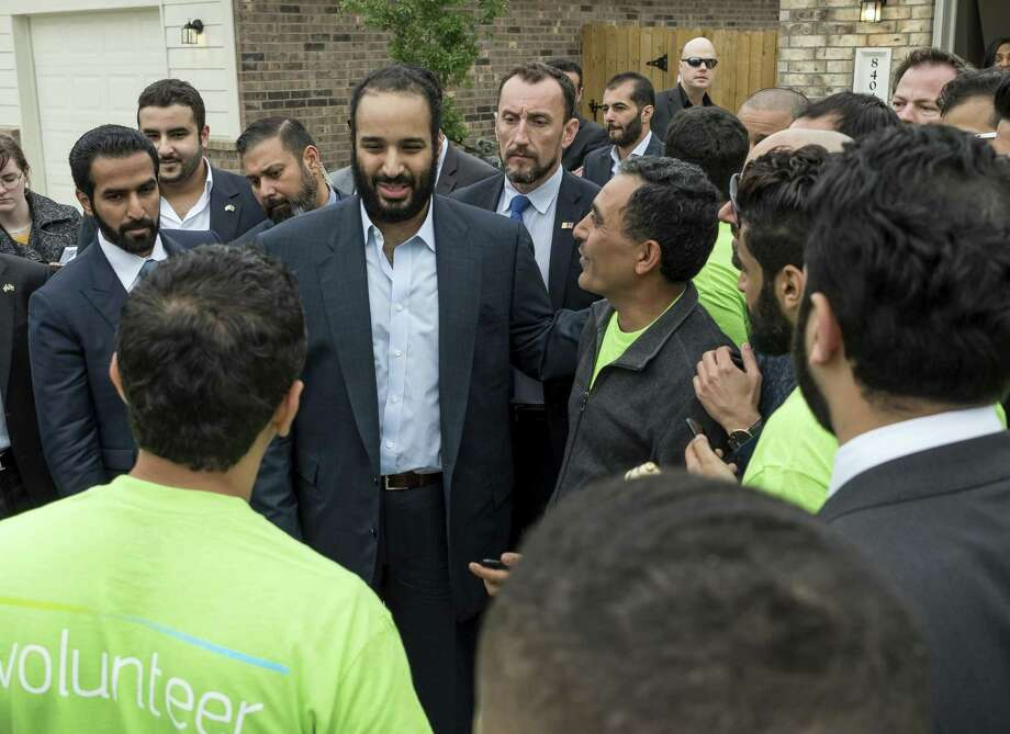 IMAGE DISTRIBUTED FOR ARAMCO SERVICES - His Royal Highness Crown Prince Mohammed Bin Salman and Houston Mayor Sylvester Turner visited with Houston's Habitat for Humanity on Saturday, April 7, 2018, in Houston, TX on the last stop of his U.S. tour. (Photo by Paul Ladd/Invision for Aramco Services/AP Images) Photo: Paul Ladd, INVL / Associated Press / Invision