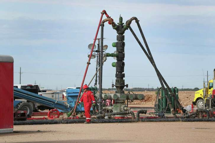 A Halliburton wellhead is visible at a fracking site in Midland.