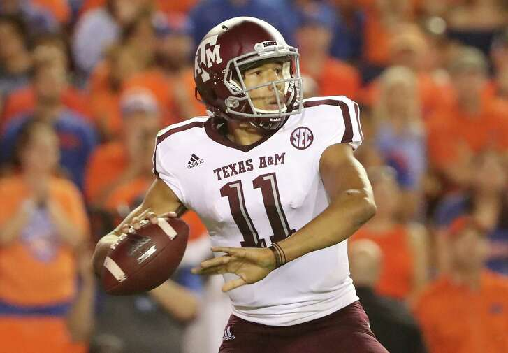 GAINESVILLE, FL - OCTOBER 14:  Kellen Mond #11 of the Texas A&M Aggies attempts a pass during the game against the Florida Gators at Ben Hill Griffin Stadium on October 14, 2017 in Gainesville, Florida.  (Photo by Sam Greenwood/Getty Images)
