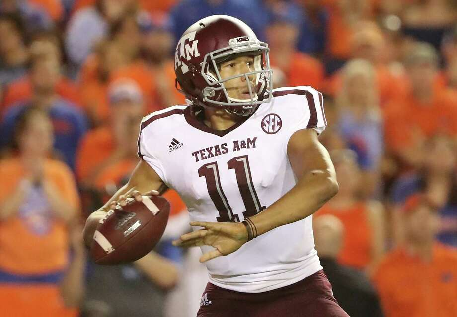 GAINESVILLE, FL - OCTOBER 14:  Kellen Mond #11 of the Texas A&M Aggies attempts a pass during the game against the Florida Gators at Ben Hill Griffin Stadium on October 14, 2017 in Gainesville, Florida.  (Photo by Sam Greenwood/Getty Images) Photo: Sam Greenwood, Staff / Getty Images / 2017 Getty Images
