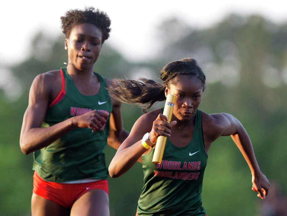 The Woodlands competes in the girls 4 x 200 meter relay during the District 12-6A high school track meet at College Park High School, Thursday, April 12, 2018, in The Woodlands. The Woodlands took first overall in the race. Photo: Jason Fochtman, Staff Photographer / © 2018 Houston Chronicle