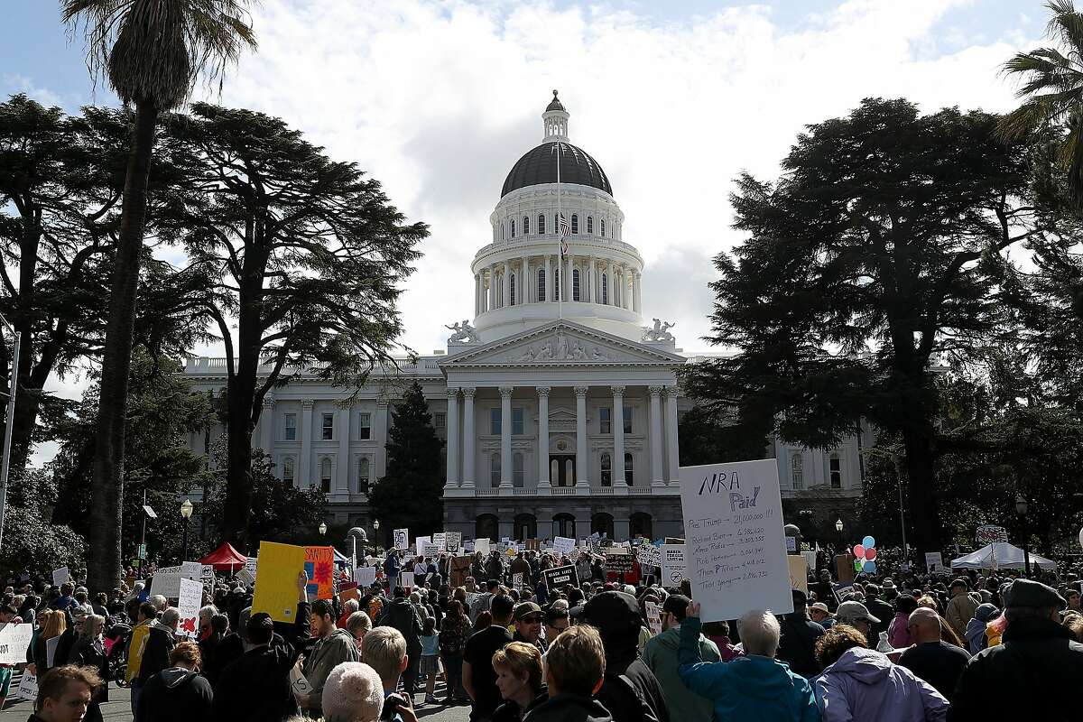 SACRAMENTO, CA - MARCH 24: Protesters gather at the California State Capitol during a March for Our Lives demonstration on March 24, 2018 in Sacramento, California. More than 800 March for Our Lives events, organized by survivors of the Parkland, Florida school shooting on February 14 that left 17 dead, are taking place around the world to call for legislative action to address school safety and gun violence. (Photo by Justin Sullivan/Getty Images)