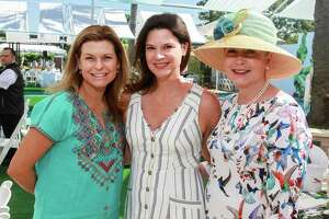 Misty Weihs, from left, Jennifer Baker and Kathleen Mach at the Clay Court Tennis Fashion Show luncheon at River Oaks Country Club.