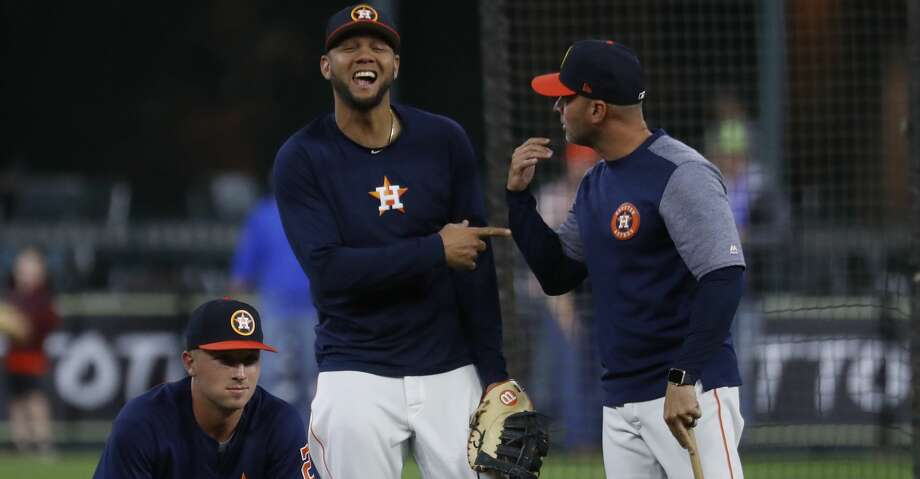 Houston Astros first baseman Yuli Gurriel messes around with bench coach Joe Espada  at batting practice before the start of an MLB game at Minute Maid Park, Friday, April 13, 2018, in Houston.   ( Karen Warren / Houston Chronicle ) Photo: Karen Warren/Houston Chronicle