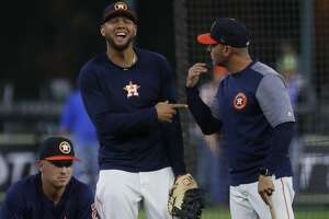 Houston Astros first baseman Yuli Gurriel messes around with bench coach Joe Espada  at batting practice before the start of an MLB game at Minute Maid Park, Friday, April 13, 2018, in Houston.   ( Karen Warren / Houston Chronicle )
