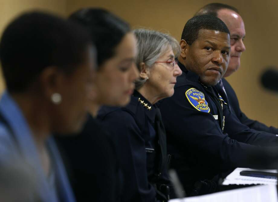 Oakland Police Chief Anne Kirkpatrick (center) and San Francisco Police Chief Bill Scott appear at an Oakland panel discussion on a current hot-button topic in community policing: officer-involved shootings. Photo: Paul Chinn / The Chronicle
