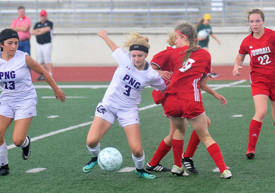 Port Neches-Groves' Abby Reeves fights for the ball against Tomball during Friday's matchup in Humble.