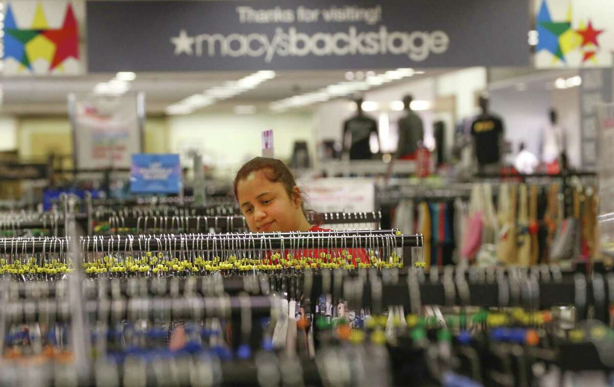 Stage Crew Member Katherine Aguilar arranges clothing in the new Macy's Backstage store Friday, April 13, 2018, in Pearland. Macy's is launching its first Backstage store in the Houston area, carving out a space in its Pearland store for a 14,000-square-foot section offering apparel and accessories at up to an 80 percent discount. ( Steve Gonzales / Houston Chronicle )