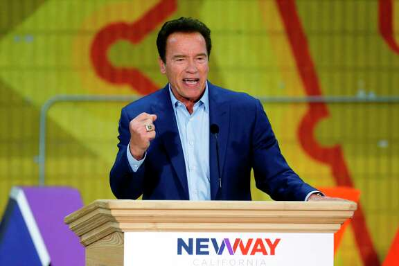 "FILE - In this March 21, 2018 file photo, former California Gov. Arnold Schwarzenegger speaks at the first New Way California Summit, a political committee eager to reshape the state GOP, at the Hollenbeck Youth Center in Los Angeles. Schwarzenegger says he's good, but not great following heart surgery. The 70-year-old ""Terminator"" actor and former California governor on Thursday, April 12,  released a short video on Twitter updating his condition and thanking people for the support. Schwarzenegger says he's feeling better, but he's ""not great yet."" He was seated at a chessboard, which he says he uses to freshen his mind and memory. (AP Photo/Damian Dovarganes)"