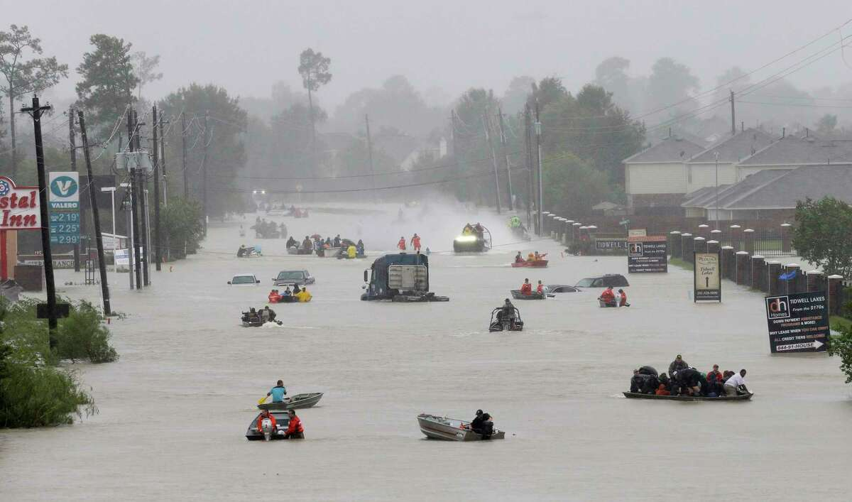 Rescue boats work along Tidwell at the east Sam Houston Tollway helping to evacuate people Monday, August 28, 2017 in Houston. Much of the area is flooded from rains after Hurricane Harvey.