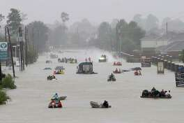 Rescue boats work along Tidwell at the east Sam Houston Tollway helping to evacuate people Monday, August 28, 2017 in Houston. Much of the area is flooded from rains after Hurricane Harvey. ( Melissa Phillip / Houston Chronicle)