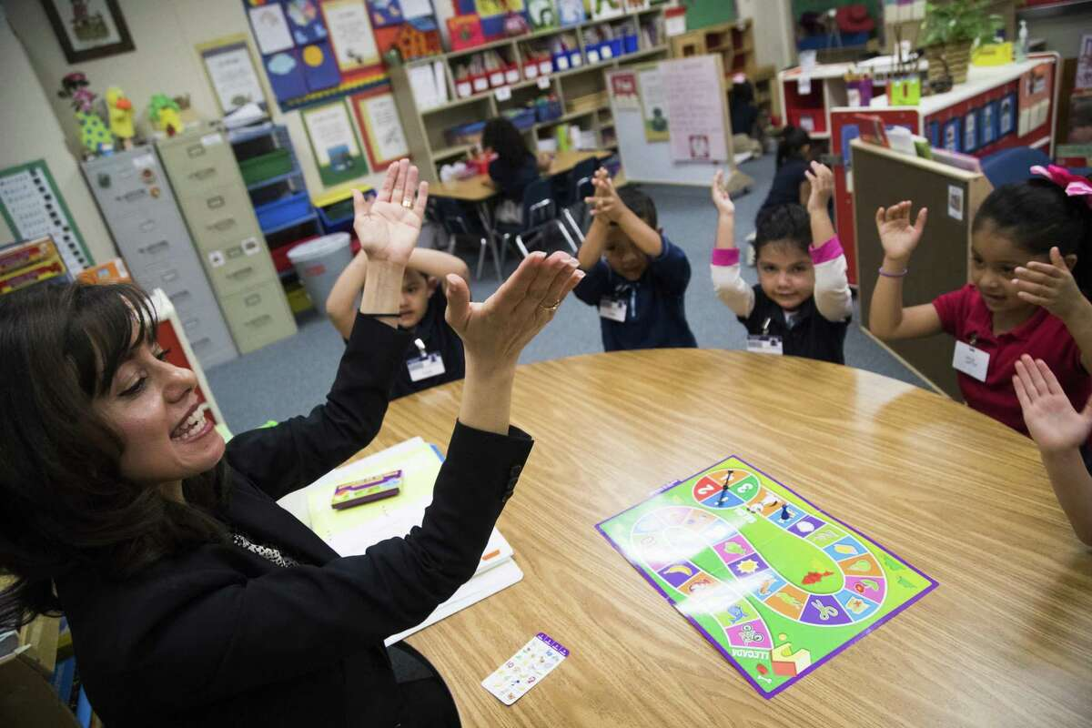 Rees Elementary School pre-kindergarten teacher Atenea Raptis counts syllables with her students, Wednesday, April 4, 2018, in Houston. Raptis has been a teacher at Alief Independent School District for 18 years. ( Marie D. De Jesus / Houston Chronicle )