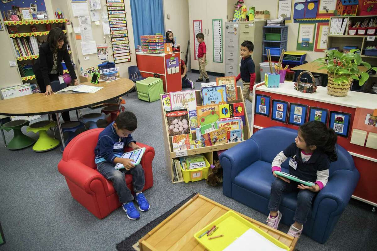 Rees Elementary School pre-kindergarten teacher Atenea Raptis goes over her list of student names calling them to join her at the table to work on writing, Wednesday, April 4, 2018, in Houston. ( Marie D. De Jesus / Houston Chronicle )