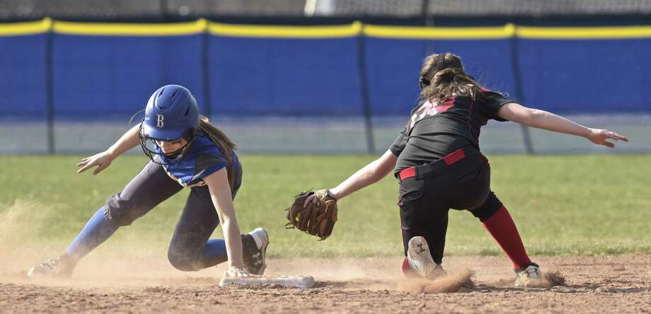 Brookfield's Laila Cofone (12) slides safely past the tag by Pomperaug's Elizabeth Sullivan (00) into second in the girls softball game between Pomperaug and Brookfield high schools, Friday afternoon, April13, 2018, at Brookfield High School, in Brookfield, Conn. Photo: H John Voorhees III / Hearst Connecticut Media / The News-Times