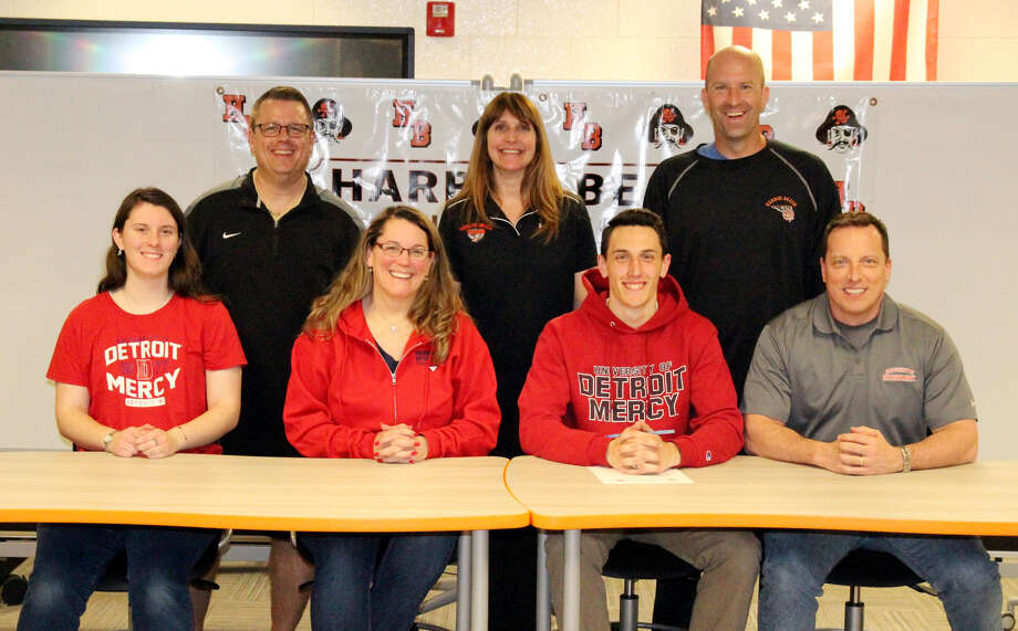 Harbor Beach track & field standout Daniel Lanfear signed his letter of intent to continue his career at Detroit Mercy, Thursday at Harbor Beach High School. His is joined by (front row from left) his sister Margaret Lanfear, mother Elizabeth Lanfear and father Daniel Lanfear Sr. In the back row are Harbor Beach athletic director Brian Fuller, Harbor Beach assistant track coach Debbie Anderson and Harbor Beach track coach Jim Tamlyn. (Mike Gallagher/Huron Daily Tribune)
