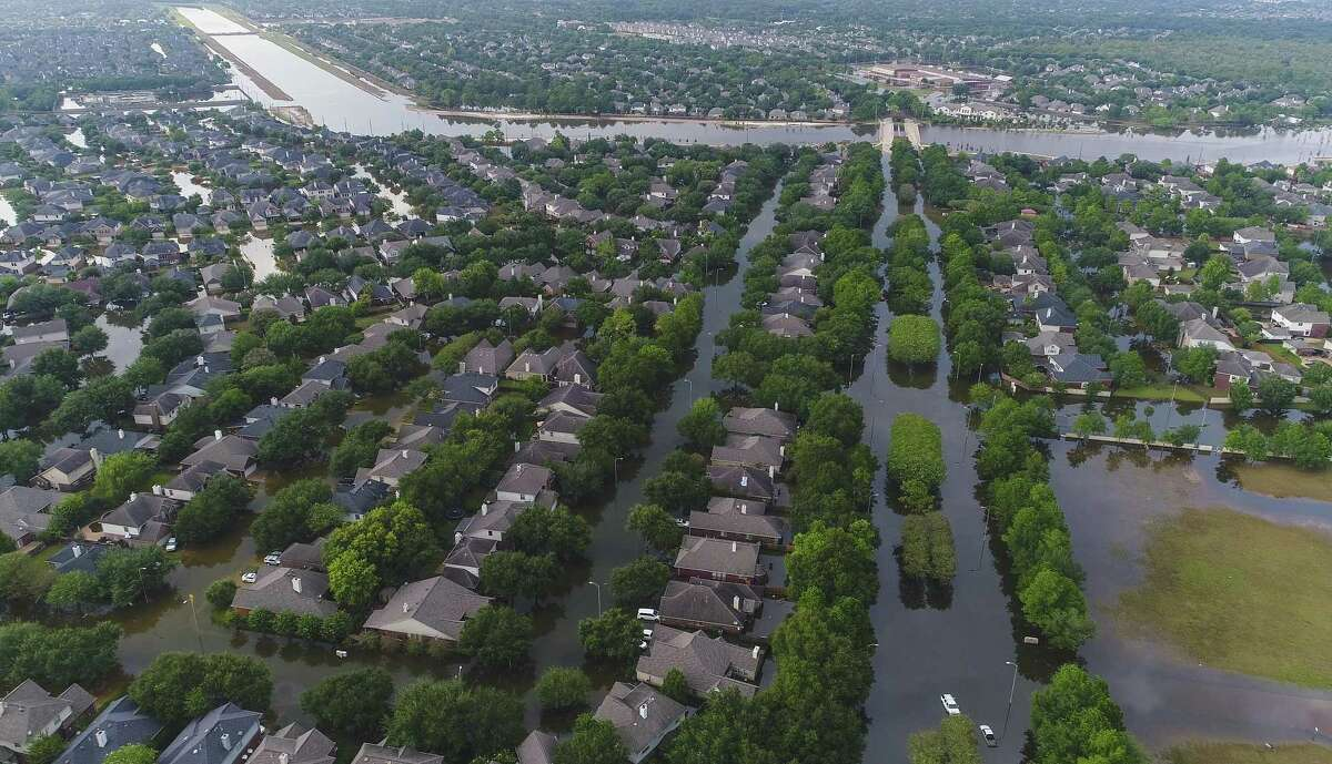 Homes in the Cinco Ranch area are surrounded by water from Barker Reservoir, Saturday, September 2, 2017, in Houston.