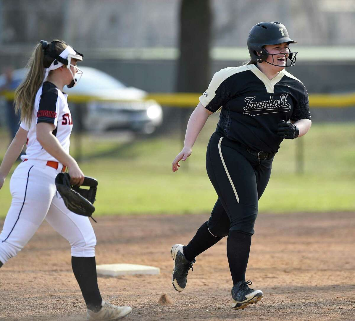 Trumbull's Delilha Destefano (25) rounds the bases following a three run homer in the third inning against Stamford at a FCIAC girls softball game at Stamford High School in Stamford, Connecticut on April 13, 2018. Trumbull defeated Stamford 5-1.