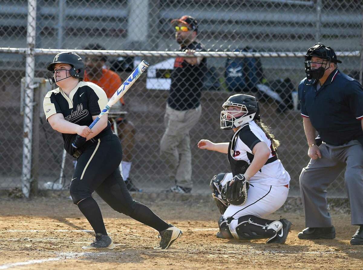 Trumbull's Delilha Destefano (25) follows he three run homer in the third inning against Stamford in a FCIAC girls softball game at Stamford High School in Stamford, Connecticut on April 13, 2018. Trumbull defeated Stamford 5-1.