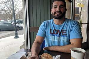 Arif Kocabs is moving to Cos Cob come April, he said at Starbucks on Greenwich Avenue on Thursday April 12, 2018. He is excited for spring to finally arrive so he can explore the wonderful things he's been reading about the neighborhood.