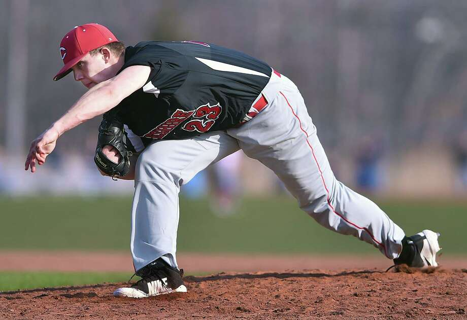 Cheshire senior southpaw Benjamin Shadeck delivers a pitch against Branford, Friday, April 13, 2018, at the baseball field at the George T. Dummar Jr. Field at Branford High School. The Rams won, 4-2. Photo: Catherine Avalone, Hearst Connecticut Media / New Haven Register