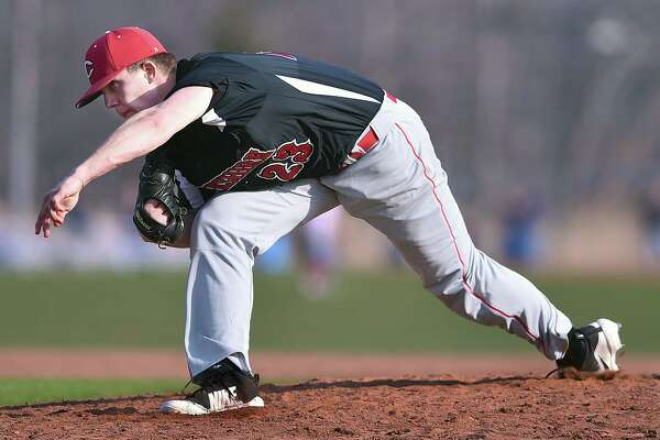 Cheshire senior southpaw Benjamin Shadeck delivers a pitch against Branford, Friday, April 13, 2018, at the baseball field at the George T. Dummar Jr. Field at Branford High School. The Rams won, 4-2.