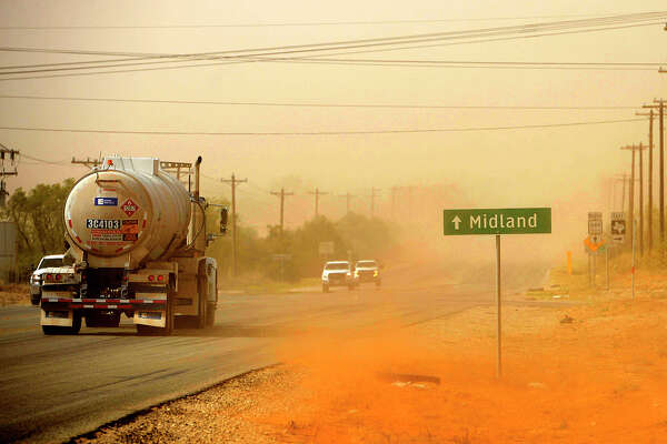 A dust storm blows into Midland as oilfield traffic passes near the intersection of N State Highway 349 and County Road 160 south of Midland, photographed April 13, 2018. James Durbin/Reporter-Telegram