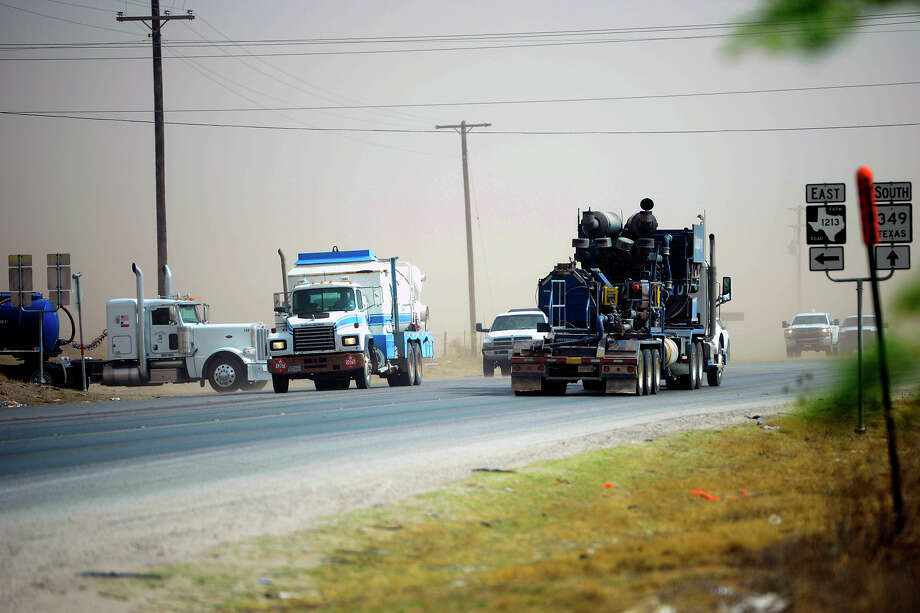Oilfield traffic near the intersection of N State Highway 349 and County Road 160 south of Midland, photographed April 13, 2018. James Durbin/Reporter-Telegram Photo: James Durbin