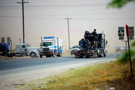 Oilfield traffic near the intersection of N State Highway 349 and County Road 160 south of Midland, photographed April 13, 2018. James Durbin/Reporter-Telegram