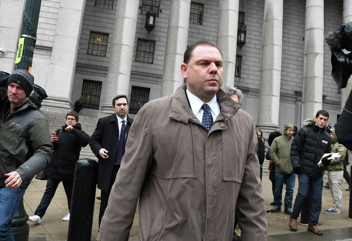 Joseph Percoco, a former top aide to Governor Andrew Cuomo, center, exits federal court in New York, U.S., on Tuesday, March 13, 2018. Percoco was found guilty on Tuesday of conspiracy to commit honest services wire fraud and solicitation of bribes. Photographer: Louis Lanzano/Bloomberg
