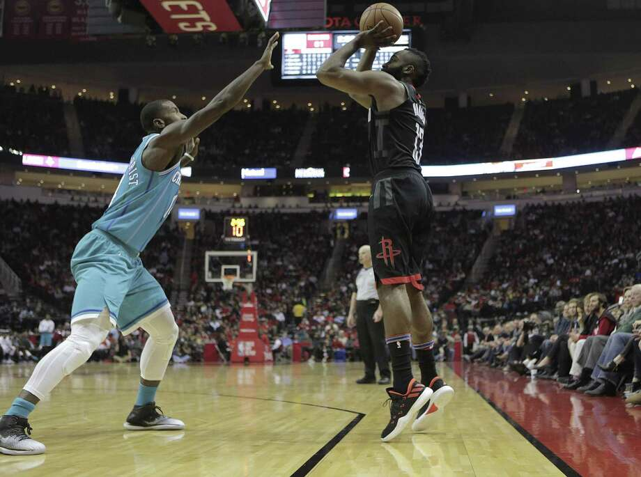 Guard James Harden, right, is at the forefront of the Rockets' record-setting 3-point offense. The Rockets averaged 17.3 3-pointers against the Timberwolves in four victories this season. Photo: Elizabeth Conley, Chronicle / Houston Chronicle / © 2017 Houston Chronicle
