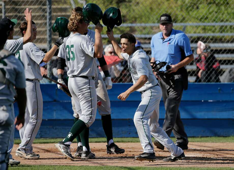 De La Salle's Taison Corio, (center) celebrates his two-run home run against Foothill-Pleasanton on his 17th birthday. Photo: Michael Macor / The Chronicle