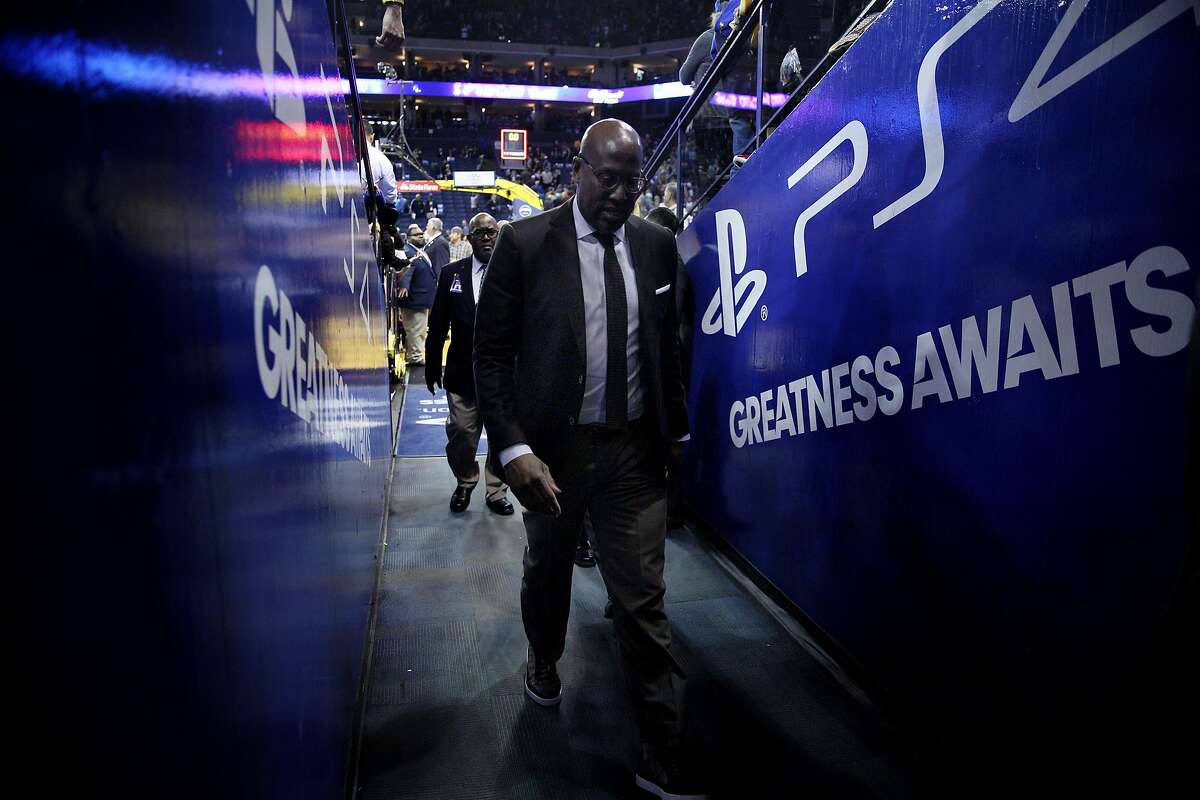 Golden State Warriors coach Mike Brown heads to the locker room following the end of an NBA game between the Golden State Warriors and Sacramento Kings at Oracle Arena, Friday, March 16, 2018, in Oakland, Calif. The Sacramento Kings won 98-93.