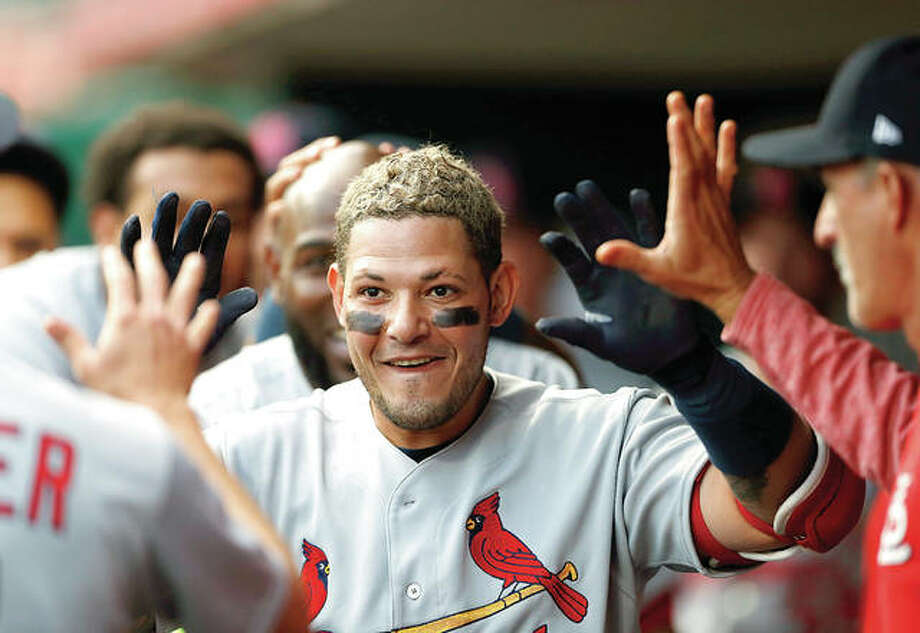 The Cardinals' Yadier Molina, center, celebrates his solo home run off Cincinnati Reds starting pitcher Tyler Mahle in the second inning of Friday night's game in Cincinnati. Photo:       AP