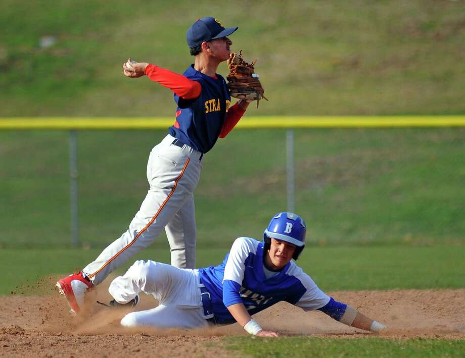 Stratford shortstop Gabriel Avila sends the ball to first after tagging out Bunnell's Justin Herrera during boys baseball action in Stratford, Conn., on Friday Apr. 13, 2018. Photo: Christian Abraham / Hearst Connecticut Media / Connecticut Post