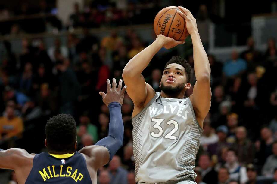 DENVER, CO - APRIL 05: Karl-Anthony Towns #32 of the Minnesota Timberwolves puts up a shot over Paul Millsap #4 of the Denver Nuggets at the Pepsi Center on April 5, 2018 in Denver, Colorado. NOTE TO USER: User expressly acknowledges and agrees that, by downloading and or using this photograph, User is consenting to the terms and conditions of the Getty Images License Agreement. (Photo by Matthew Stockman/Getty Images) Photo: Matthew Stockman / 2018 Getty Images