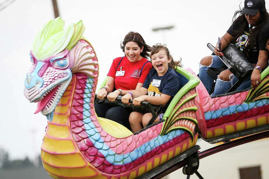 Lori Wilcox, a Conroe ISD substitute teacher, left, rides a carnival ride with Lamar Elementary fourth grader Heidi Corrigan, right, during the Special Education Day for the Montgomery County Fair on Friday, April 13, 2018, in Conroe. Photo: Michael Minasi, Staff Photographer / © 2018 Houston Chronicle