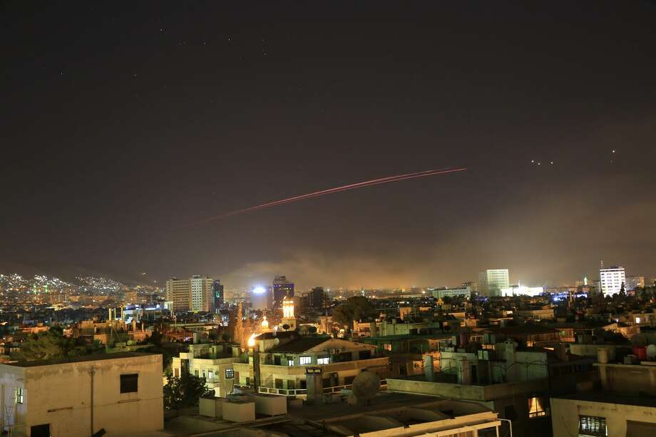 Damascus skies erupt with anti-aircraft fire as the U.S. launches an attack on Syria targeting different parts of the Syrian capital Damascus, Syria, early Saturday, April 14, 2018. Syria's capital has been rocked by loud explosions that lit up the sky with heavy smoke as U.S. President Donald Trump announced airstrikes in retaliation for the country's alleged use of chemical weapons. (AP Photo/Hassan Ammar) Photo: Hassan Ammar/Associated Press