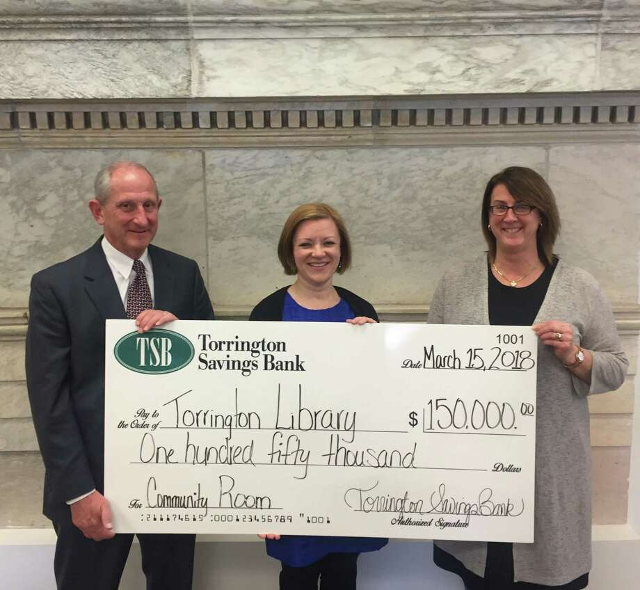 Torrington Savings Bank has made a $150,000 donation to the Torrington Library, for the recently named Torrington Savings Bank Community Room. This new gathering space was created during the latest renovation of the library which was completed in 2016, and aligns with the bank's commitment to community and provides a valuable benefit to all, according to a release. The Torrington Library encourages public use of meeting rooms as gathering places to exchange ideas, access and share information and participate in programs created for public enjoyment, public education and civic engagement. From left are John E. Janco, president and CEO of Torrington Savings Bank, Jessica Gueniat, director of the Torrington Library, and Lesa A. Vanotti, senior vice president and CFO of Torrington Savings Bank and a Corporator of the Torrington Library. Photo: Contributed Photo / Torrington Savings Bank